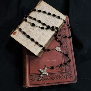 Vintage rosary with black beads.